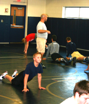 Young wrestlers stretching